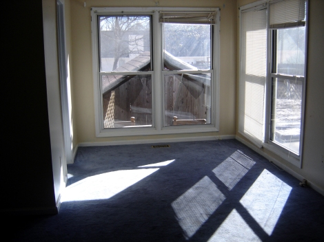 """Before - nook area. Note the """"building"""" in the window. That's a pig roof over the hot tub!"""